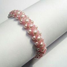 Woven Pearl Bracelet Elegant Pink Pearl Bracelet by ItsAbracadebra. What a gorgeous bracelet! #pink #jewelry #etsyshp