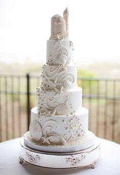 gorgeous beach sand castle wedding cake...only way bigger! Lol. I LOVE sand castles so this is appropriate :)