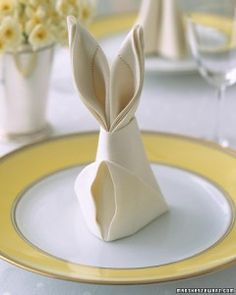 Easter table decor just got a whole lot cuter with this bunny fold idea for napkins! (via marthastewart.com)