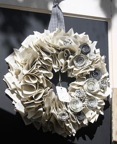 Love the combination of sheet music and paper roses for this wreath.