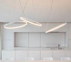 HALO 100 + 60; With its very light and minimal design halo creates an archetypical light circle. The soft light is directed upwards and downwards while its highly efficient led-light curves along with the lamp shape • TPL LIGHTING • MERGING LIGHTING WITH DESIGN • TPLLIGHTING.COM • TORONTO, CANADA •