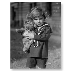Little boy in sailor outfit with his teddy bear, 1923.