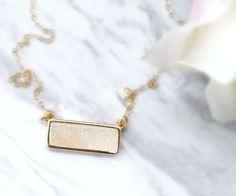 Light Druzy Bar Necklace. This dainty necklace is so sparkly and perfect for gifts.