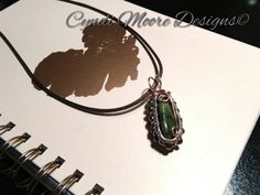 Handcrafted Woven Wire Wrapped Moss Agate Pendant / Necklace. Free Shipping to all US orders!! See this and more at http://cyndimooredesigns.storenvy.com/products/23569152-woven-wire-wrapped-moss-agate-pendant-necklace #necklace #leather #agate #mossagate #Wirewrapped #boho #gypsy #handmadejewellery #ilovehandmade #jewelryaddict #jewelrystore #jewelrylovers
