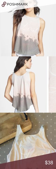 """New with tags. Wildfox """"Lost Angeles"""" Tank New with tags. Wildfox """"Lost Angeles"""" Tank. Lose yourself in the soft, cool comfort of this cotton-blend tank. Printed with a hazy picture of a SoCal sunset. 50% cotton, 50% polyester. Made in the U.S.A. Wildfox Tops Tank Tops"""