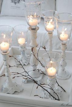 Candlesticks in worn white.
