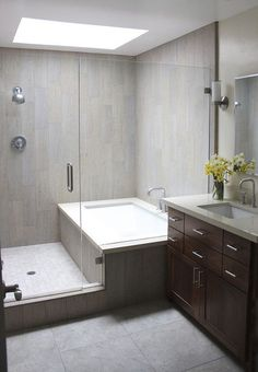 combined bath shower converted into separate ones glassed in together; used wood plank looking tile Small Bathroom, Master Bathroom, Corner Bathtub, Budgeting, Small Toilet, Small Shower Room, Master Bath, Compact Bathroom, Master Bathrooms