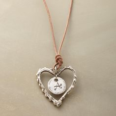 """PERSONALIZED LOVE NOTE NECKLACE--A personalized love note necklace to wear and cherish, crafted of leather and sterling silver, and inscribed with the initial of your choice. Handmade. ByJes MaHarry. Sterling silver clasp. 18""""L."""