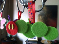 DIY Felt Very Hungry Caterpillar decoration, perfect for baby showers or kid birthdays! Hang from your chandelier or anywhere to accessorize!
