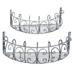 """Set of two iron planters with scrollwork detail.   Product: Small and large basketConstruction Material: IronColor: SilverDimensions: 7.25"""" H x 19.75"""" W x 9.25"""" D (large)"""