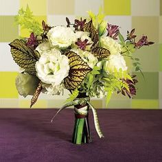 Green and purple balance each other out in this bouquet of coelus, lisianthus, Japanese toad lily, Jasmine foliage and green hydrangea