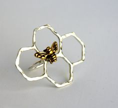 This slightly smaller version of my ever popular Honey Knuckles ring features a handmade sterling silver honeycomb that I hammered and