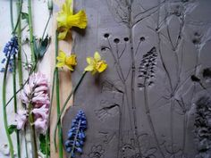 Artist Rachel Dien uses clay to capture the details of the flowers, then uses a wood frame and pours plaster onto it.