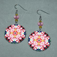 Dangle earrings adorned with my pink Peruvian lily boho chic mandala new age sacred geometry hippie kaleidoscope design titled Tickled Pink. <br /> <br />These lightweight, dainty silver earrings begin with a dangle of light topaz Swarovski crystal beads and a pink heart Swarovski crystal bead that accentuates the colors in the mandala charm that has scalloped edges%...