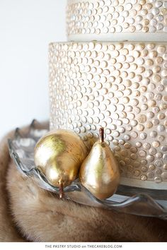 Gorgeous golden cake glittering with grommet-inspired metallic buttons and topped with golden pears. Refined and elegant cake inspiration by The Pastry Studio. Pear Drawing, Golden Cake, Pear Cake, Elegant Cakes, New Years Eve Party, Wedding Cakes, Candle Holders, Candles, Holidays