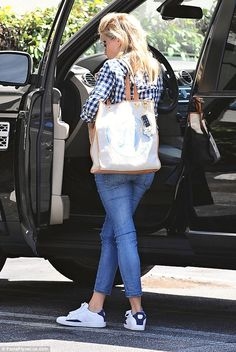 Product placement: The Oscar winner carried a tote bag from her new website Draper James...