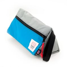 """small toiletries bag... triangle shape """"allows it to sit upright"""". yup!!   (plus... it's made in the USA)   thanks www.topodesigns.com"""