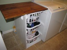 DIY Projects Laundry Cabinets - Shorter Brook laundry basket dresser with folding table Brag from Ana White Utility Room Storage, Laundry Table, Basement Laundry Room, Folding Table, Room Remodeling, Laundry Basket Dresser, Small Laundry Room Organization, Room Storage Diy, White Washing Machines