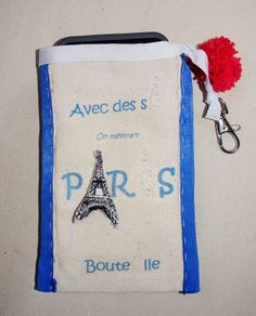 ideal for not loose cellphone and keys into the sand. This lovely pocket is handmade with grosgrain ribbon, tissue, wool french pompons. Handmade tour Eiffel with tissue and padding - 25US$ (phone not included)