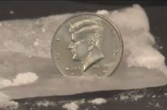 Watch What Happens When You Insert A Coin Into Dry Ice | IFLScience
