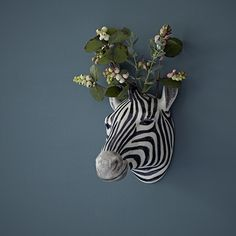 Quail Hand Painted Zebra Wall Vase: This hand painted ceramic zebra wall vase is a tongue in cheek way to add a dash of the exotic to your walls. Great on its own or with foliage as a display piece or a quirky way to keep kitchen utensils or pens. A Quail Ceramic product that comes packaged in an attractive box
