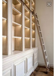 Note the lighting under the shelves. If they are adjustable, what about using ribbon lights along the inside of the stile/face frame instead? Bookshelf Lighting, Ladder Bookshelf, Library Bookshelves, Library Ladder, Library Wall, Bookcase Wall, Bookshelf Styling, Bookshelf Decorating, Large Bookshelves