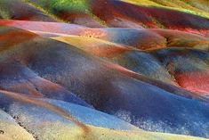 Seven Colored Earth of Chamarel, Mauritius - The multicolored earth in Chamarel was formed when volcanic rock cooled at different temperatures.