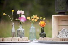 eclectic vases, simple flowers