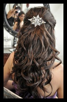 half updo with a gorgeous crystal piece perfect for a veil or as the accessory for the bride not wanting to wear a veil