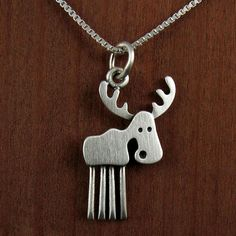 This wild little moose is made of brushed sterling silver. He measures about 3/4 tall, which means that this is quite a TINY moose, but thats a