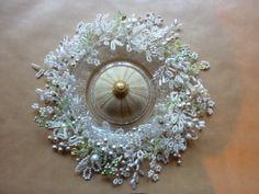 beaded flower wreath with sea urchin