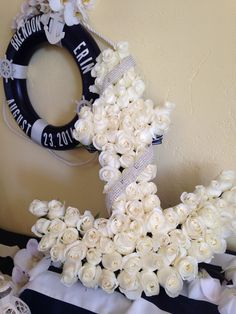 The very first gift my husband ever gave me was an anchor charmed necklace which was the inspiration of this beautiful white rose anchor for my nautical themed wedding.