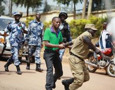"""Ronald Muhinda, a journalist with Uganda's Radio One fm is forcefully thrown out of the cordoned area during the """"Occupy The Daily Monitor and Red Pepper"""" protest. He lost his belt in the scuffle, registering minor injuries along the way Uganda, Kairo, Along The Way, Freedom, Challenges, Natural Resources, Pepper, Lost, Space"""