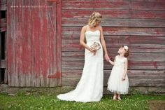 Sweet shot of a bride and her flowergirl outside of a barn. Brooch bouquet by The Ritzy Rose #WeddingTrends#2013 #CCRitzyRose Photo by Kimberly Potterf