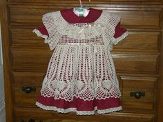 Burgundy sewn dress and crochet pinafore