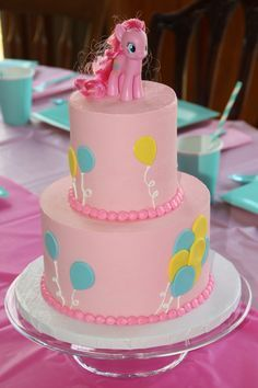 My Little Pony Pinkie Pie Cake My Little Pony party: Pinkie Pie Birthday Cake! Pinkie Pie Cake Pinkie Pie cake For zays mini cake, like the rosettes maybe as a border to look like mane/tail. Shabby Chic 1st Birthday Party, My Little Pony Birthday Party, Girl Birthday, Birthday Cake, Birthday Ideas, Pinkie Pie Party, Cumple My Little Pony, My Little Pony Cake, My Little Pony