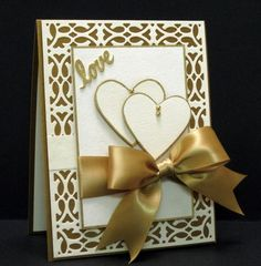 Stamps: None  Paper: Paper Source Luxe Cream, Gold  Ink: None  Accessories: Cheery Lynn Designs Cathedral Lace Frame, SU Heart Punch, Martha Stewart Love Punch, Paper Source Gold Ribbon, Gold Leaf Pen, Gold Beads