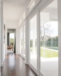 """Stritt Design and Construction on Instagram: """"Sunlight streams through the hallway at our Bungan Beach residence. The custom timber and glass sliding doors were designed for easy indoor…"""""""