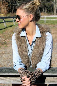 Furry vest, chambray shirt, black pant
