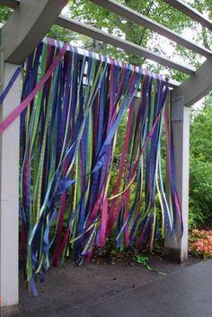 Hang ribbon from a branch or rod ... at the entrance to the children's garden at…