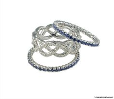 18 karat white gold stackable rings. Available in various sizes and colors. Available at 14 Karat Omaha.