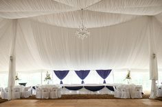 Stunning! Purple and crystal bling all set in a beautiful white draped tent!