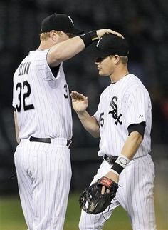 Chicago White Sox first baseman Adam Dunn (32) pats second baseman Gordon Beckham on the head after the White Sox 7-2 win over the Cleveland Indians after a baseball game Tuesday, May 1, 2012, in Chicago. (AP Photo/Charles Rex Arbogast)