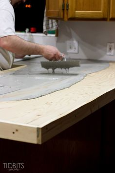 Details and instructions for installing DIY feather finish concrete countertops, and the possible complications you could face with this trending method.