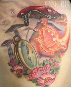 Alice in Wonderland tattoo...love this! Possibly put a mad hatter hat and queen of hearts card in there somewhere.