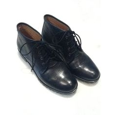 Pair of Eileen Fisher black leather ankle boots $20. Donated to ASPCA.