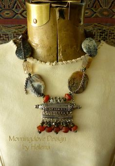 This type of prayer box /amulet is traditional to Gadoliya and Banjara women living in Rajasthan. This striking design melds the traditional with the contemporary. Old vintage hertz from India is made of good tribal silver, adorned with contemporary carnelian and turquoise dangles.