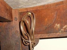 Ten House Things We Can't Live Without...ex: using a cup hook to corral lamp and other electrical cords under tables