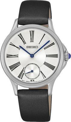 Seiko Dameshorloge Staal-Leder SRKZ57P1. Kaliber 6G28. Een elegant horloge met een blauwe zijde/leren band en een witte, bewerkte, wijzerplaat. Het horloge weegt 32 gram en is 50 meter waterdicht. Met Cabochon knop. Het gebruikte glas is van het type Hardlex dat speciaal voor Seiko wordt gemaakt. een mooi en trendy horloge.