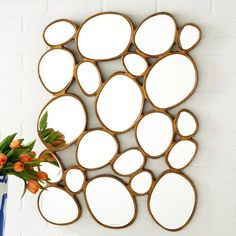 "A free form mirror made up of organic circles. 23"" W x 1"" D x 32"" H"